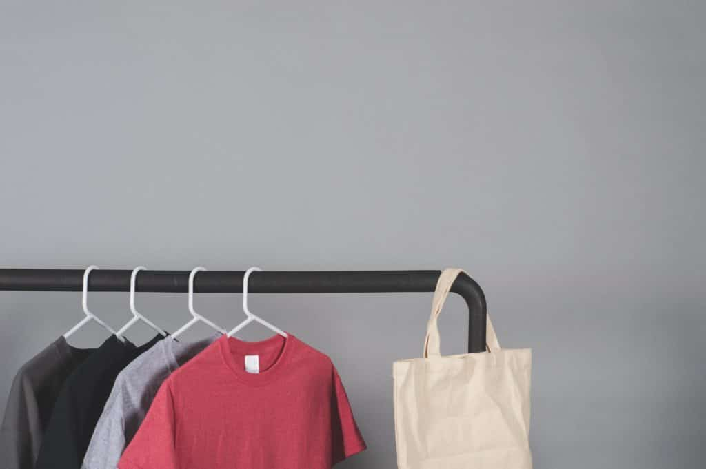 clothes-rail-beside-gray-wall